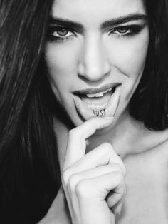 """Lust"" lip tattoo - One good word for a lip tattoo. But you have to be really good looking to pull it off."