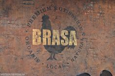 """See how Brasa has a chicken in the middle of the circular graphic to ground things. If Dub's had something like that (not the V, it's too big), then """"Dub V's"""" could run across it."""