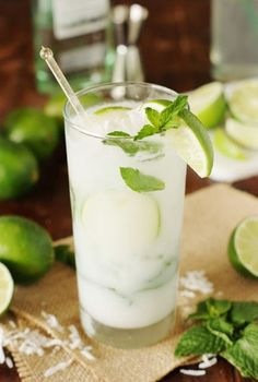 Coconut Mojito ~ Ditch the margaritas, and enjoy a refreshing Coconut Mojito for your Cinco de Mayo ... or any day ... sipping.  Such a delicious combination of fresh mint, lime, & coconut!   www.thekitchenismyplayground.com