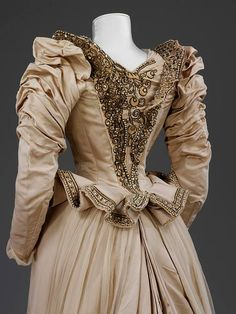 Heavy cream embroidered corded silk wedding dress and trained skirt made after Paquin Lalanne et Cie, Paris and worn by an American heiress in 1890 -detail You may find it at The Victoria and Albert Museum , in London.