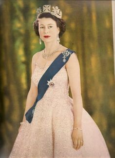 Coronation of Queen Elizabeth II, June 1953.     Her gown incorporated all the floral emblems of Great Britain.