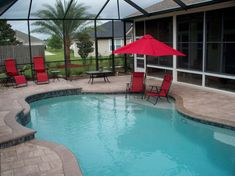 Swimming pool ideas. Sun shelf for chairs, raised beam and deck for waterfall, Umbrella holder in swimming pool.