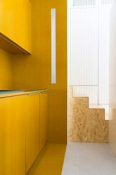 The architects used blue for the bedrooms to evoke a sense of calm and rest, while a vibrant yellow provides the backdrop for the kitchen.