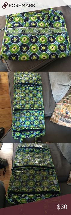Beta Bradley make up bag This Korgis and brand-new never used a vera Bradley make up or travel bag has three pockets with zippers and clear so you could see what's in each pocket. Pet and smoke free home it folds up and has a handle so it can be carried very easily. It's navy blue white blue green and white colors. About a foot long and 8 inches folded up Vera Bradley Accessories