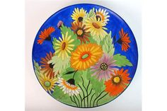 A Carlton Ware handcraft Art Deco plaque the plaque decorated in enamels with stylised coloured d
