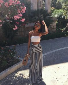 I don't know if I could pull this off but I like it | stripes | high waisted wide legged pants | tube top