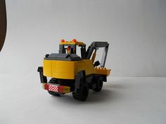 Hello, all! I am posting a new creation of mine. It is a wheeled excavator, modeled in John Deere-ish colors. It has a working arm (obviously), blade on the...