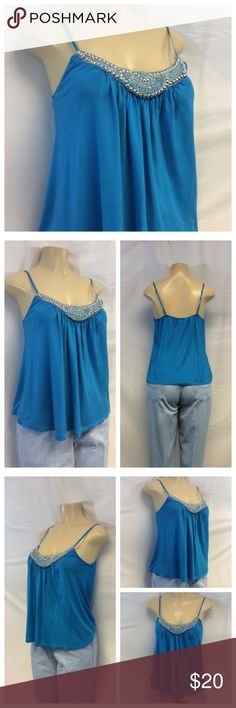 "CANDICE Silver Beaded Blue Top Size L CANDICE Silver Beaded Blue Top with adjustable spaghetti straps n scoop neckline. Gathers in front center of yoke, Size L. 100% rayon, machine washable. Approx measure- ments are 24"" shoulder to hem, 18"" bust laying flat. 030 (tags cut out) Candice Tops"
