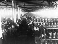 Crowded factory with staff facing the camera at Blackstaff Mill