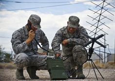 Airman 1st Class Anthony Giampapa and Senior Airman Brandon Lopez operate a mobile ground radio satellite system Aug. 15, 2013, at Nellis Air Force Base, Nev. The 99th Communications Squadron Airmen use mobile systems while at home station or deployed. Giampapa and Lopez are radio frequency transmissions systems journeymen. (U.S. Air Force photo/Senior Airman Brett Clashman) (Photo by Senior Airman Brett Clashman)