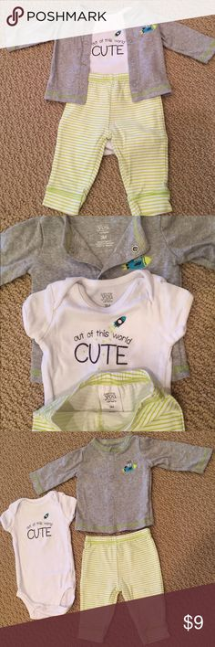 """Carter's 3-piece baby boy set - Size 3months Carter's Just one you 3-piece baby boy set - Size 3months.  Grey/white/lime green.  1 white """"out of this world cute"""" onesie, 1 grey snap-up cardigan with bulldog rocket, 1 pair of striped pants.  Gently used. Carter's Matching Sets"""