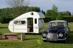 Early innovation attempt caravan system with flex roof.
