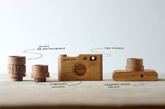 Wooden toy camera with interchangeable lenses
