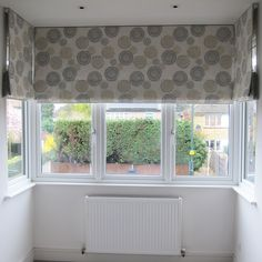 Roman blinds in a square bay in exquisite hand printed linen by Galbraith and Paul- design Zinnia, with narrow grey linen border Windows With Blinds, Bay Window Blinds, Curtains With Blinds, Bay Windows, Bay Window Bedroom, Bedroom Windows, Blue Bedroom, Grey Roman Blinds, Decor Blinds