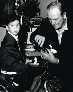 John Wayne putting together a bicycle Christmas morning