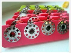 Now this is genius!!!! Use a pedicure toe seperater as bobbin organizer.