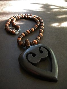 Sankofa Heart Wood Necklace by AfriqueLaChic on Etsy, $25.00