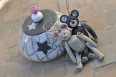 Ours déco en céramique grise et rose