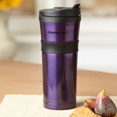 A double-walled, stainless steel tumbler with flip-top lid, rubber hand grip and deep purple finish.