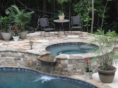 Concrete spa by Hilltop Pools and Spas, Inc.