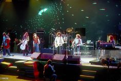LOS ANGELES - AUGUST 1977: Cellists Melvyn Gale and Hugh McDowell, violinist Mik Kaminsky, guitarist and singer Jeff Lynne, drummer Bev Bevan, bassist Kelly Groucutt, and piano player Richard Tandy of the rock and roll band 'Electric Light Orchestra' perform onstage in August 1977 in Los Angeles, California. (Photo by Richard Creamer/Michael Ochs Archives/Getty Images)