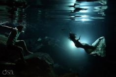 Riviera Maya photography, underwater trash the dress session in a cenote. Love a mermaid bride!  Mexico wedding photographers Del Sol Photography