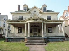 "Would You Buy One of These Decaying Mansions? Medina, NY Price: $89,900  Zillow says: ""This eight-bedroom, nine-bath historic home has architectural details like stained glass windows, woodwork, and hardwood floors. With fresh paint and some updates, the listing says it could be a bed and breakfast."""