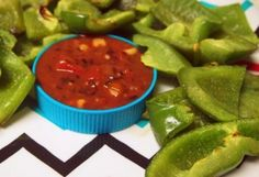 1 tbsp. olive oil, 1 tsp. garlic sprinkled over green peppers, baked at 350° for 10 minutes.  A much healthier 'chip' for dipping.