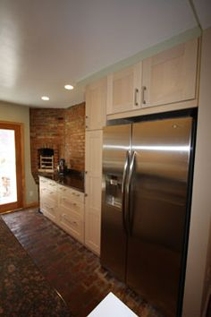 Kitchen with stainless steel refrigerator www.stokesrealtor.com