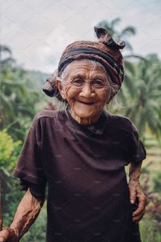 Portrait of old woman standing outdoors and smiling at camera. Senior female with beautiful smile on her face. Beautiful Old Woman, Beautiful Smile, Beautiful People, Creative Market, Old Faces, Woman Smile, Ageless Beauty, Gaucho, Woman Standing
