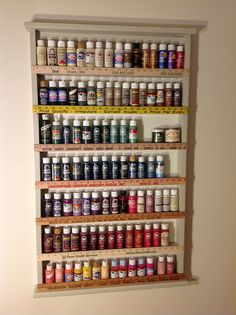 paint shelf made from wood and yardsticks repurposed from Habitat Restore