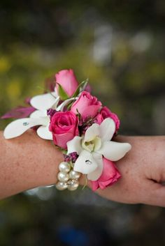 White orchids and pink spray rose wrist corsage on pearls Homecoming Flowers, Prom Flowers, White Orchids, White Flowers, In Bloom Florist, Wrist Corsage, Spray Roses, Prom Girl, Senior Prom