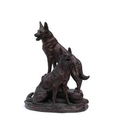 A large antique French figure of two German Shepherds. The piece has been cast from spelter and has been plated in copper. The dog statue is