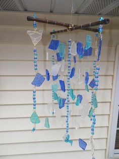 Blue sea glass windchime with 3D beaded dolphin. $100.00, via Etsy.  Nice idea for all my sea glass :)