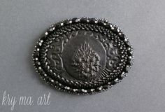 brooch with over 30 years of cameos wrapped in Toho beads frosted jet, sl gray, sl frosted gray, transparent gray and fire pilish frosted jet