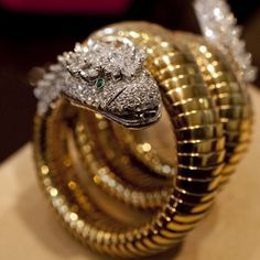 """A Diamond, Emerald And Gold """"Snake"""" Bracelet Watch, by Bvlgari from the collection of Elizabeth Taylor Ruby And Diamond Necklace, Emerald Bracelet, Snake Bracelet, Snake Jewelry, Fine Jewelry, Bracelet Watch, Bvlgari Bracelet, Dragon Bracelet, Elizabeth Taylor Schmuck"""