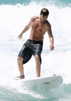 One Direction's Liam Payne showed off his beach bod while surfing near Sydney, Australia.
