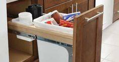 Trash pull out drawer. #RhodeIslandKitchens