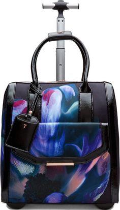•Website: http://www.cuteandstylishbags.com/portfolio/ted-baker-london-black-floral-cosmic-bloom-travel-bag/ •Bag: Ted Baker London Black Floral 'Cosmic Bloom' Travel Bag