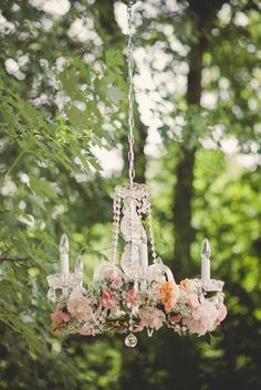 Some pretty blooms like baby's breath, Juliet garden roses and peonies give this timeless crystal chandelier added romance. | TheKnot.com
