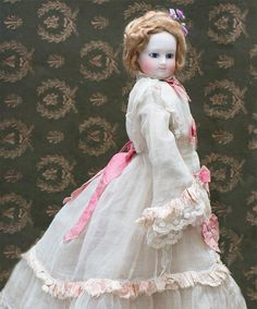 "18"" (46 cm) Antique Superb French Bisque Wooden-Bodied Fashion doll with bisque hands, in original gown"