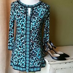 "INC Teal and Black Leopard Print Tunic Top This is a small INC leopard print tunic top. It is 95% Polyester and 5% Spandex. It is teal and black with small flat metal studs on the front. It is machine washable. It is 26"" long with 3/4 sleeves. The sleeves are 19"" long. It is 14"" from shoulder seam to shoulder seam. It looks really cute with black leggings and heels! INC International Concepts Tops Tunics"