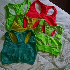 *SOLD* Sports Bra's Set of 5 sports bars. All of them are a size large and I am selling them in a bundle only! Some barely worn and some never worn. I just decided to try a different type instead of these! Lime green, yellow, fuscia pink, sparkly blue, green/white tydye. Tops
