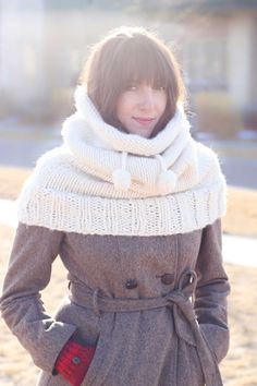 "This hooded cowl free knitting pattern is a true showstopper! Even in all it's oversized glory, it's very simple to create which makes it a great beginner pattern for learning how to knit in the round. Made with Lion Brand Wool-Ease Thick & Quick in ""Fisherman."""