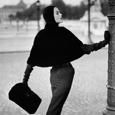 Anne St Marie Wearing a seal skin slip cover cape by Pierre Balmain, Photo: Henry Clarke for Vogue, 1955