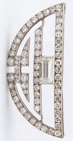 Marchak - An Art Deco platinum and diamond semi-circle brooch, circa 1920. Signed and numbered. #Marchak #ArtDeco #brooch