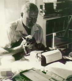 Ernest Hemingway typing on Vintage Typewriter with his Cat as Company