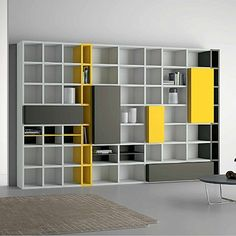Italian Design Contemporary 'Speed 22' Bookcase. The flamboyant and bright yellow gives a touch of colour to the bookcase but also to the room! The piece is available in different colours.