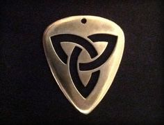 Solid Titanium guitar pick.  super strong, incredibly light-weight, solid grip, durable as hell... This is the pick that rocks as hard as you do.