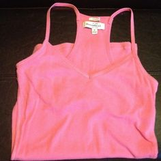 Pink racer back tank Abercrombie and Fitch pink racer back tank. It's sized medium but fits like a small Abercrombie & Fitch Tops Tank Tops